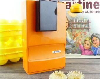 Open boxes electric orange 1970s Calor