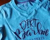 Dirt Barbie Adventures - Turquoise & Navy ink Graphic Tee Shirt - Kids V-neck Cotton Slub Tshirt - Kids Shirt by DearSeed -Handlettered