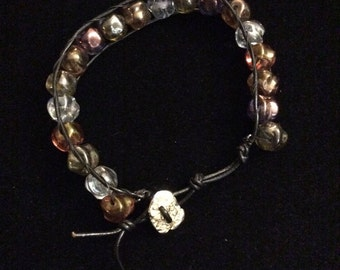 Glass bead and leather bracelet