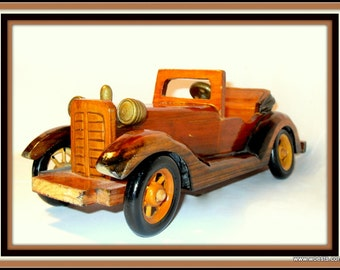 Decorative model of a antique cabriolet car made of woodcarvings. Handcarved wooden oldtimer carved  of wood. Vintage car replica. Gift idea