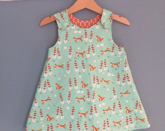 Reversible Foxglove and Foxes pinafore dress. Sizes 0-3 months - 18-24 months