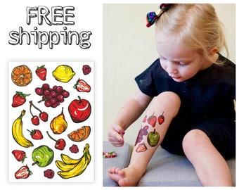 Juicy temporary tattoo set Fruits. Comics style tatts: orange, strawberry, lemon, raspberry, grape, cherry, banana, apple, pear. TA041