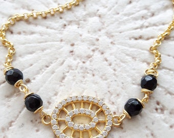 Silver bracelet with Zircons and Onyx charm