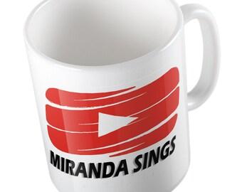 Miranda sings red play button mug