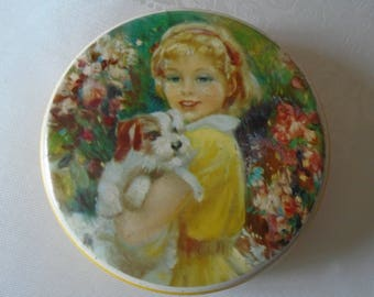 Holland's toffee tin image   girl with puppy