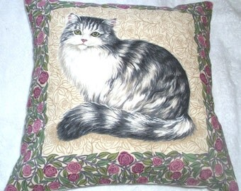 A very pretty fluffy grey tabby and white cat cushion