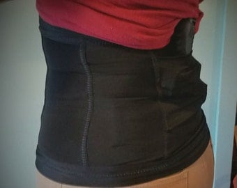 Multi pocket concealed carry corset