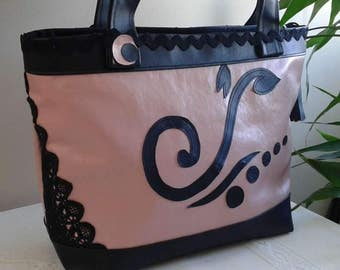Black and pink leatherette Tote handbag is closed with zipper