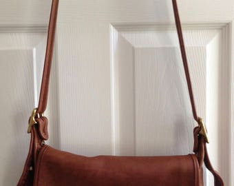 Front Flap Coach Brown Leather Messenger Bag in good shape.