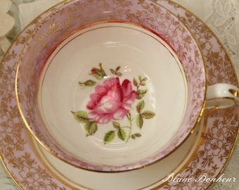 Staffordshire, England: Pink tea cup and saucer with pink rose