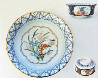 Vintage Japanese Blue and White Ceramic Bowl with Vignettes of Floral Ornamentation