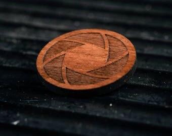 Aperture Badge