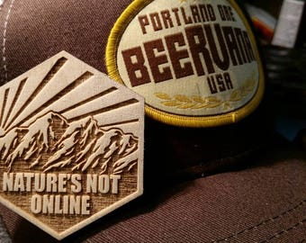"""Nature's Not Online. 2.5"""" Velcro-backed wooden morale patch."""