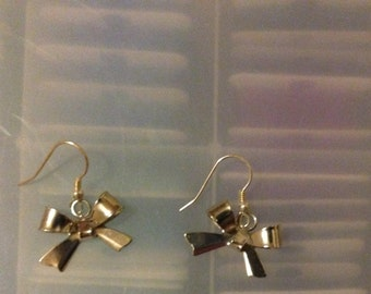Silver bow dangle earrings made with sterling silver plated earwires