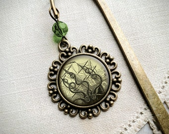 Seamonster brass book hook  or Kraken bookmark with dangling glass cabochon accent
