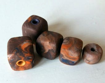 Mix of chunky cube beads. Polymer clay. Brown's and oranges.