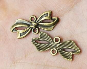 10pcs Antique Bronze bowknot Charm Pendants for Necklace / accessory DIY 11 mmx 28 mm (500-316)