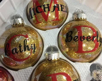 Personalized round ornament with initial and name