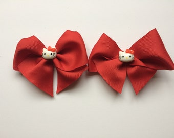 Red Hello Kitty pigtail bows