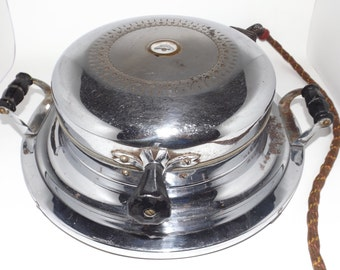 """Dominion Chrome vintage waffle maker with cord,WORKS,7"""" round,fabric cord,ornate design,wood handles,old kitchen appliance,waffle machine"""