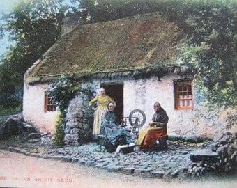 Irish Postcard A Cottage in an Irish glen (posted) / thatched roof cottage / Women spinning / Pictorial Post Card