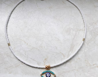 Evil eye charm in white