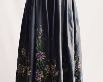 Long bright embroidered skirt.