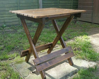 Wooden home or garden fold away table perfect for afternoon drinks, games, picnics etc. Indoor table outdoor table