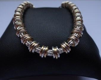 Sterling Silver and 14ct Gold Floating Bracelet
