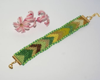 Bracelet beads woven golden yellow green