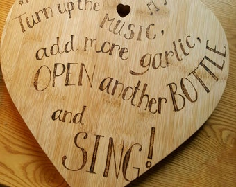 Heart shape chopping board with the ultimate kitchen mantra