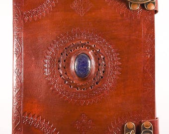 Leather journal with crystal and handmade paper.