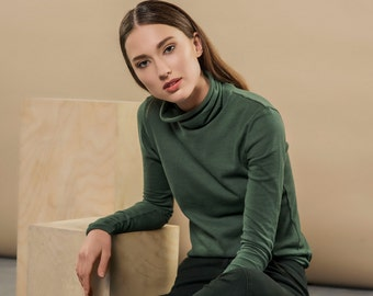 GREEN turtleneck - this close-fitting knit cotton turtleneck is made from 100 percent cotton with  extra long sleeves