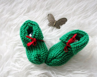 Green slippers and their red ribbon