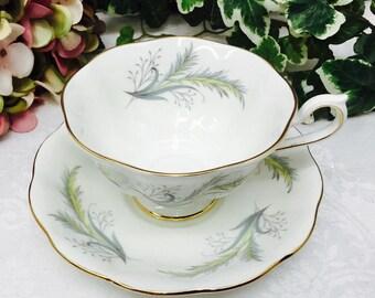 """Royal Albert """"Rendez-Vous"""" teacup and saucer."""