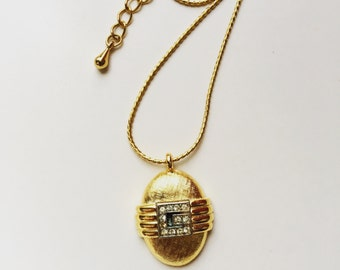 Authentic Vintage signed Givenchy gold tone charm necklace era 1980s
