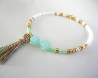 Beads Bracelet in mint/white/gold colors with two synthetic coral Roses.