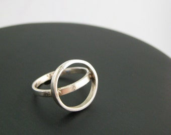 Minimal silver ring with circles, geometric ring.