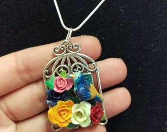 Bird and roses pendant