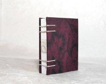 A7 floral print handbound Coptic stitch mini notebook (7.5x11 cm)