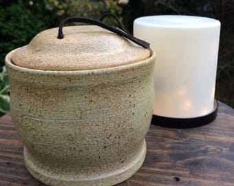 Ceramic lidded jar with leather handle