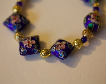 Purple Necklace with pink flowers