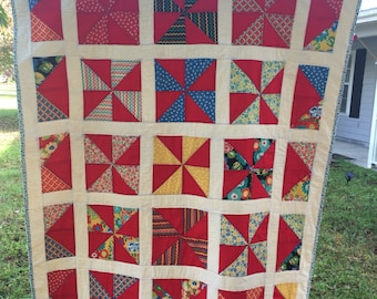 Pinwheel lap quilt, red and white quilt, lap quilt.