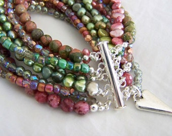 MULTI STRAND BRACELET ... shades of pink and green