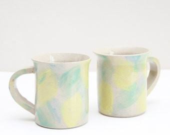 two yellow green blue brushed cups, coffee cups, shiny, pottery, ceramic, handmade, wheel thrown, glazed