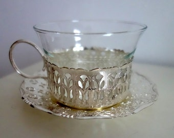Decorative pierced silver cup and saucer by Quist, West Germany