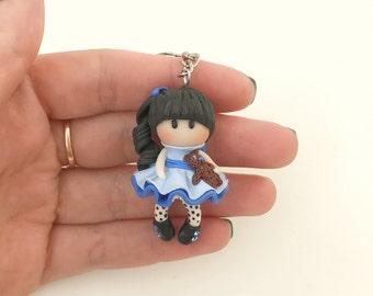 Little Girl with Dangling Legs Blue Dress