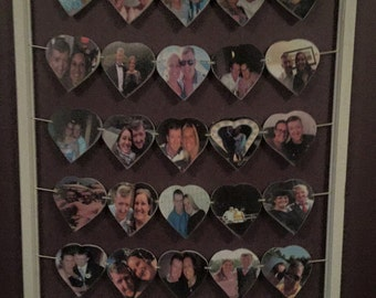 25 heart framed photo bunting.  Hand cut and hand made.