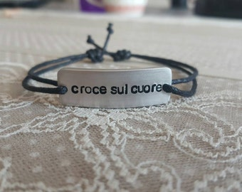 Custom engraved bracelet made of aluminium.
