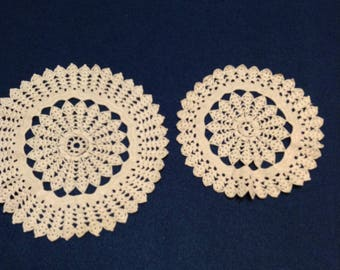 Pair of matching vintage thread crochet doilies in a taupe color.